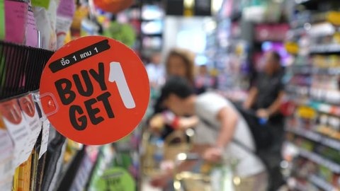 Buy 1 Get 1 Free Red Promotion Sign In A Supermarket. Closeup. 4K.