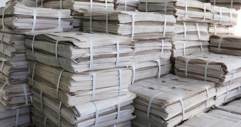 Huge piles of printed newspapers printing shop