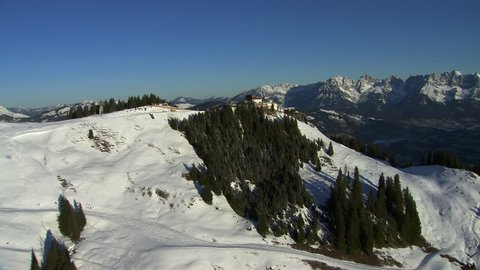 WS AERIAL Snowy mountains with ski resort / Wilder Kaiser, Kitzbuhel Alps, Tyrol, Austria