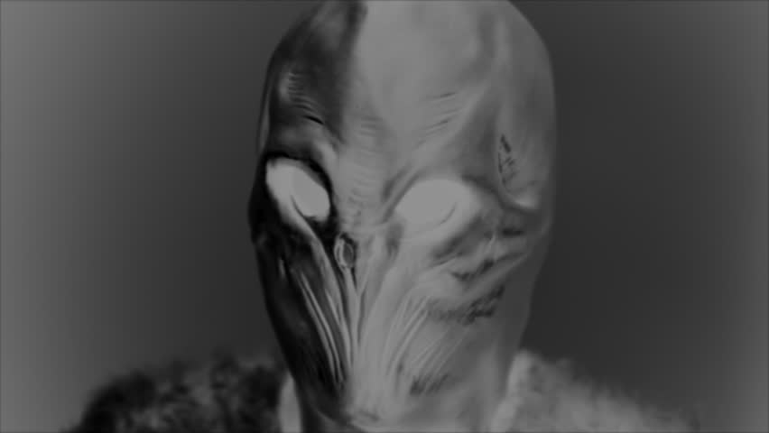 CREATURE FROM ANOTHER PLANET.  Black and white, retro-looking shot of the head of an alien.