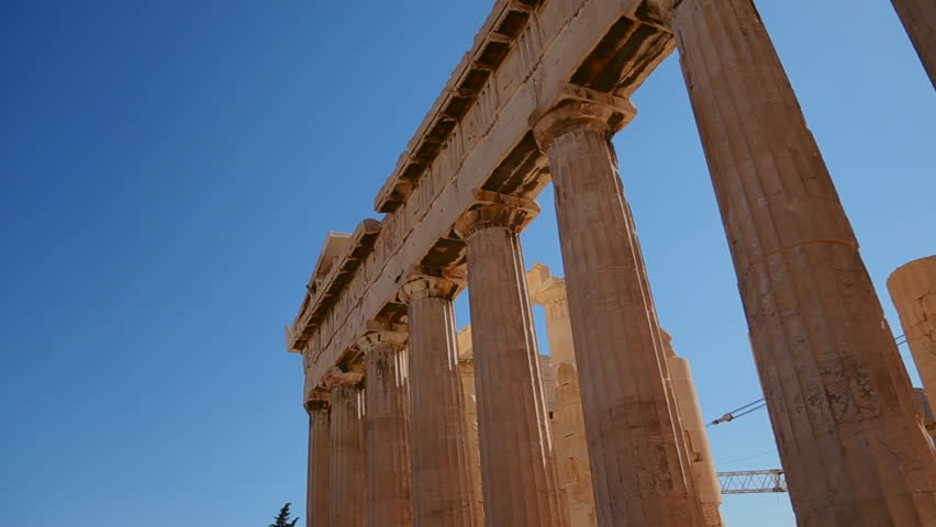 ATHENS, GREECE 2012 Low angle pan of the columns of the Acropolis and Parthenon on the hilltop in Athens, Greece.