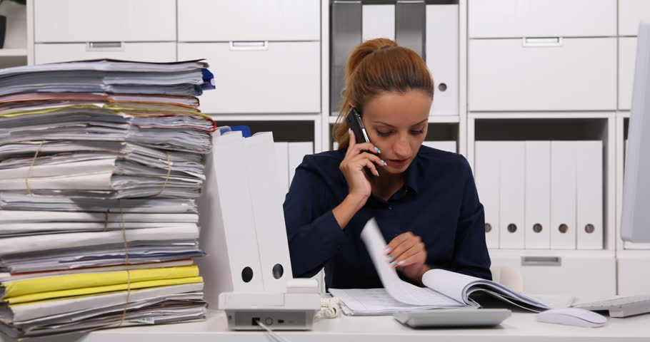 Accountant Woman Talking Mobile Phone Browsing Tax Documents Accountancy Office | Shutterstock HD Video #32584534