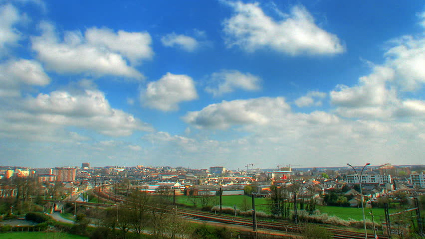 Clouds over city, HD time lapse clip, high dynamic range imaging
