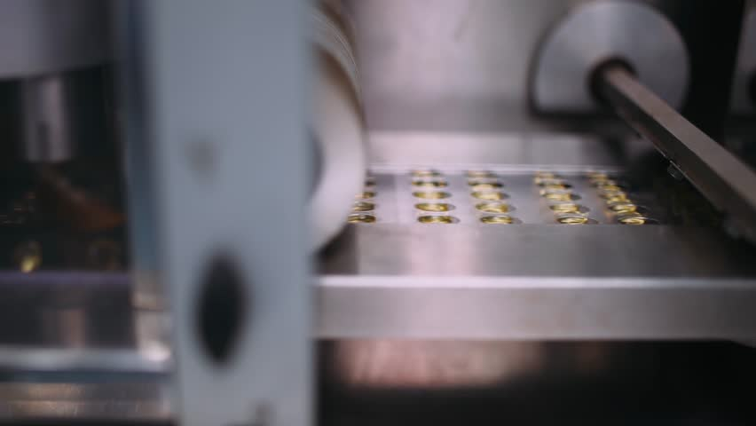 Production of pharmaceuticals and drugs, gelatin capsules in package on the conveyor, packing of tablets.