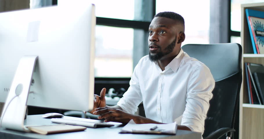 Young Black Man Working Use Computer In Office Smiling