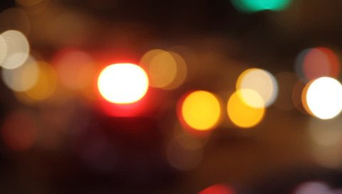Police lights of a special car flashing in the evening at the scene. Bokeh effect