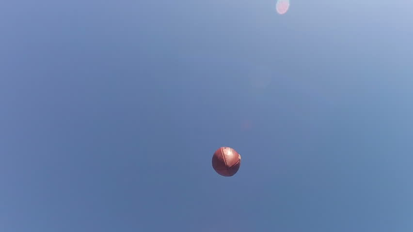 Slo-mo of a football being caught by receiver