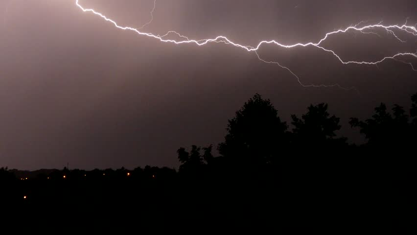 Strong thunderstorm with lightning at night. Thunder and lightning at night. Video with audio.