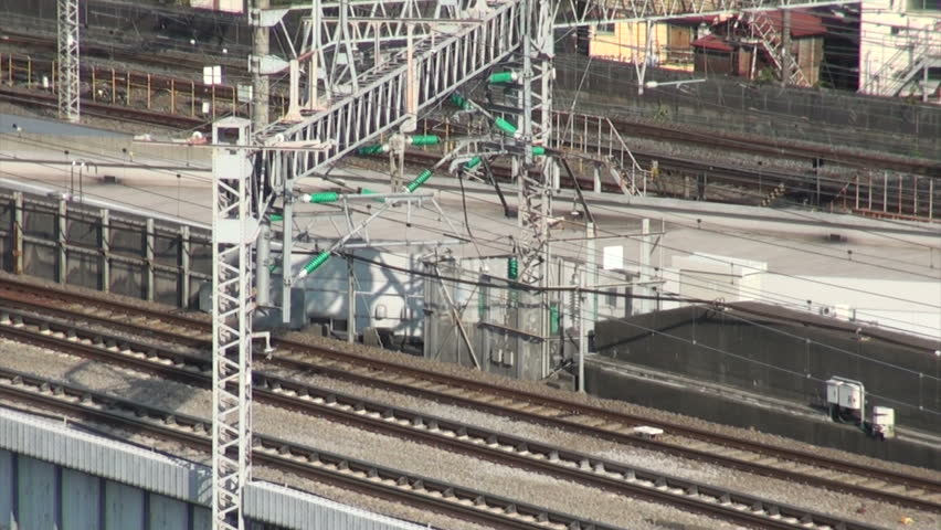 ODAWARA, JAPAN - 16 OCTOBER 2012: A Shinkansen (fast bullet train) making its way from Tokyo to Nagoya near Odawara station, Japan