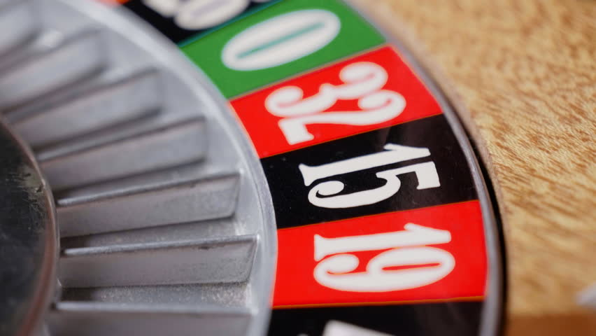 Macro shot of a roulette in a casino where the ball goes to the green or red or black number. People having bet and bet money may have won lost badges. Concept of: fate, gambling, luck, destiny. | Shutterstock HD Video #32706574