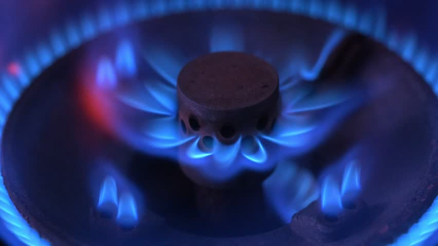 Close up macro shot of the blue flames from the burner of a gas stove. Liquid petroleum gas (LPG).