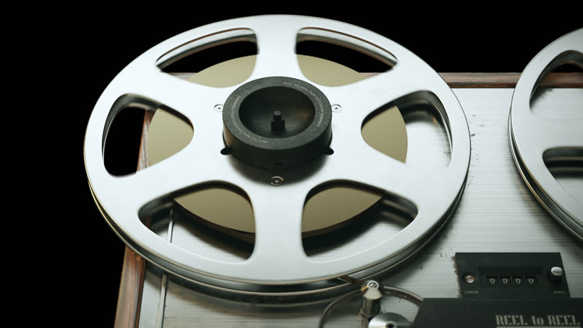Closeup on reel-to-reel magnetic tape recorder