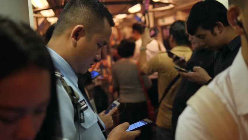Asian People Using Smart Phones and Gadgets Inside BTS Subway Train Wagon. 4K. Bangkok, Thailand - 12 NOV 2017.