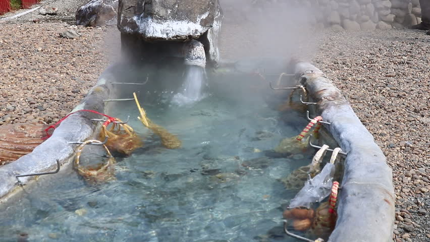 Eggs in the basket are boiled in hot springs at sankamphaeng hot springs chiangmai,Thailand   Shutterstock HD Video #32823466