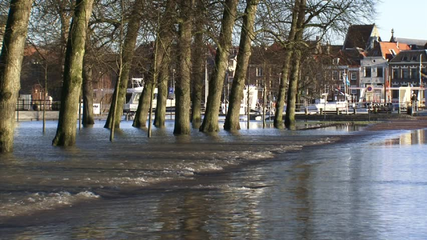 DEVENTER, THE NETHERLANDS - January 2011: flooded road, quay in background, zoom out parking lot, due to high water level in river IJssel