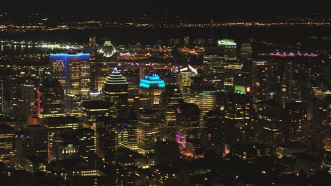 Montreal Quebec Aerial v112 Flying low over downtown at night panning with cityscape views