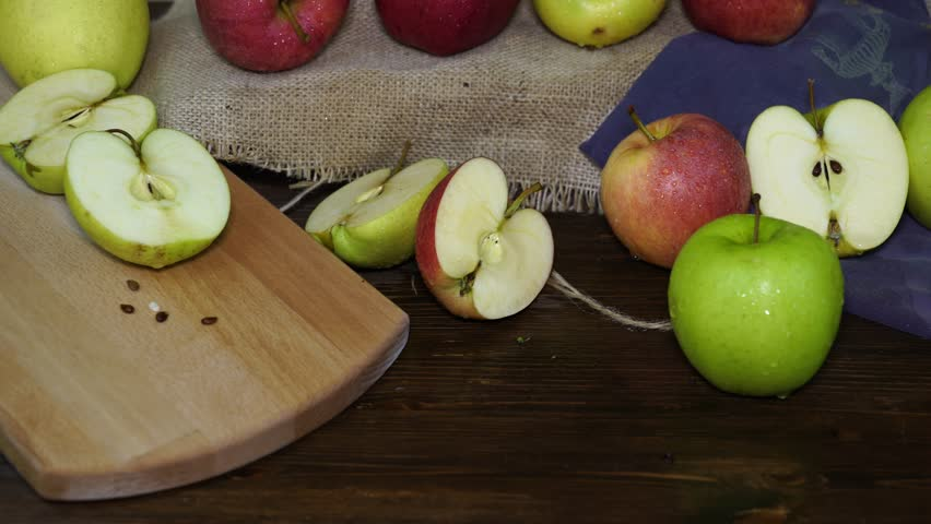 Red and green apples sliced on a table. | Shutterstock HD Video #32868841