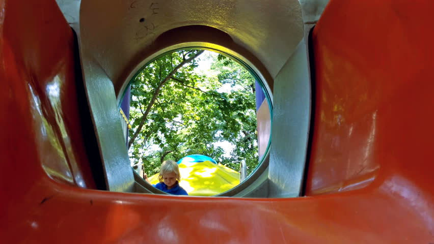 Little blonde boy playing on slide in the park | Shutterstock HD Video #32874934