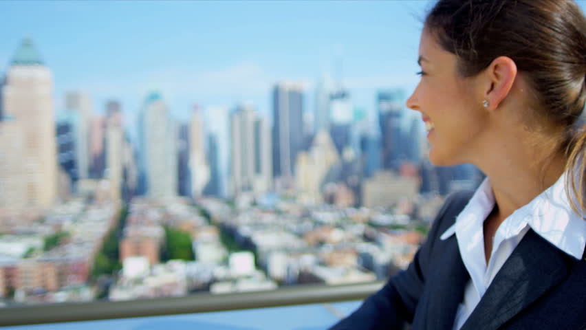 Portrait of successful Caucasian female executive manager on rooftop overlooking city