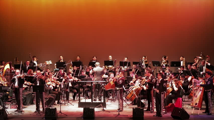 MEXICO, GUANAJUATO - CIRCA OCTOBER 2012: Symphonic orchestra concert by night and stage illuminated during the Cervantino Cultural Festival
