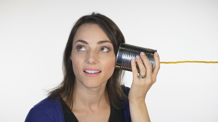 Attractive woman listens to tin can. Obsolete telephone communication.  | Shutterstock HD Video #32958073