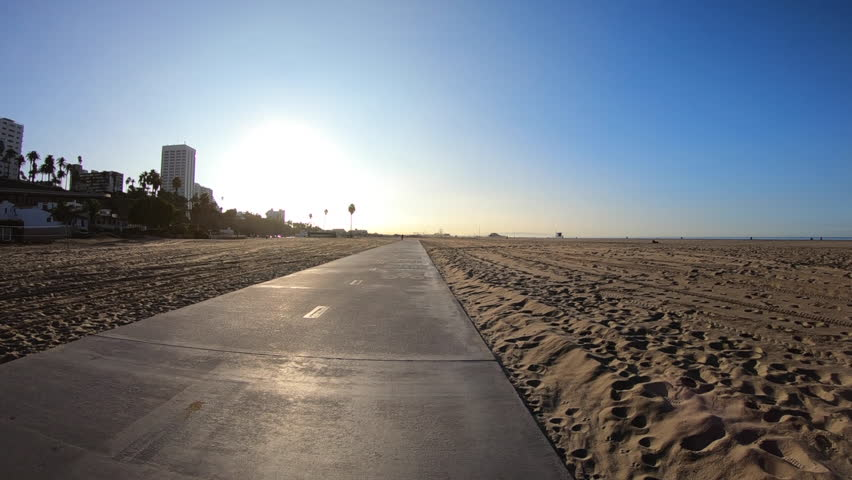 Los Angeles beach bike path with slow motion movement towards morning sun. | Shutterstock HD Video #32976256