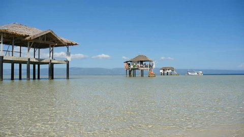 beautiful beach huts on pristine tropical Philippine island at