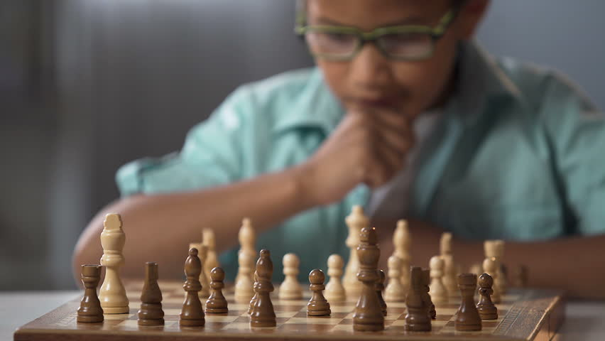Child going in circle on chess, development of logical thinking for children