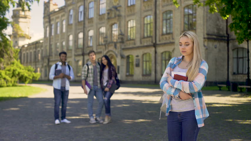 Group of multiracial fellows mocking humble newcomer girl at university | Shutterstock HD Video #33020443
