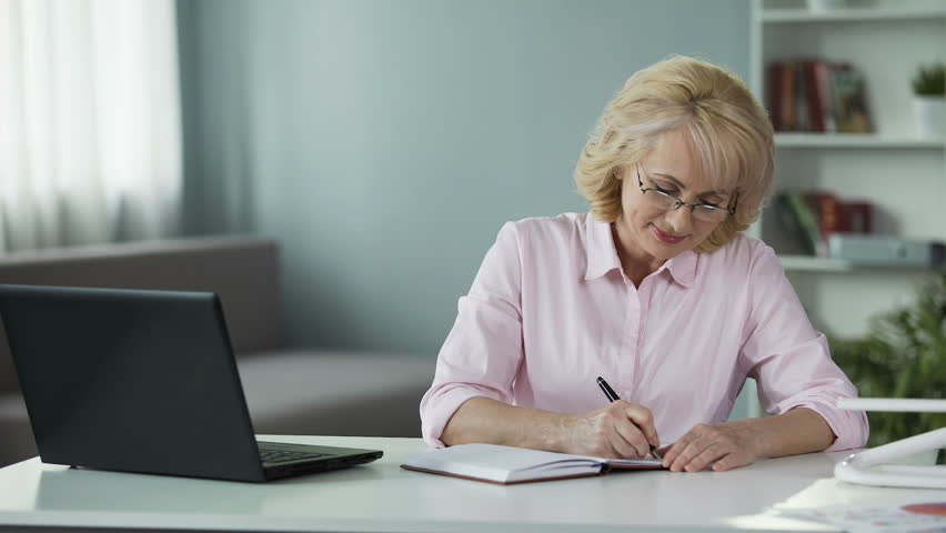 Business woman writing down to notebook plan for near future, freelancer | Shutterstock HD Video #33021634