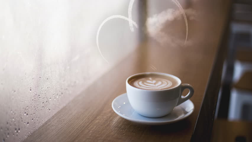 Real Planes forming a smoke heart above cup of coffee 4K