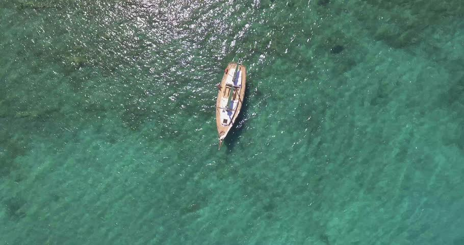 Aerial, a lonely saling ship in a beautiful bay with crystalline water | Shutterstock HD Video #33037999