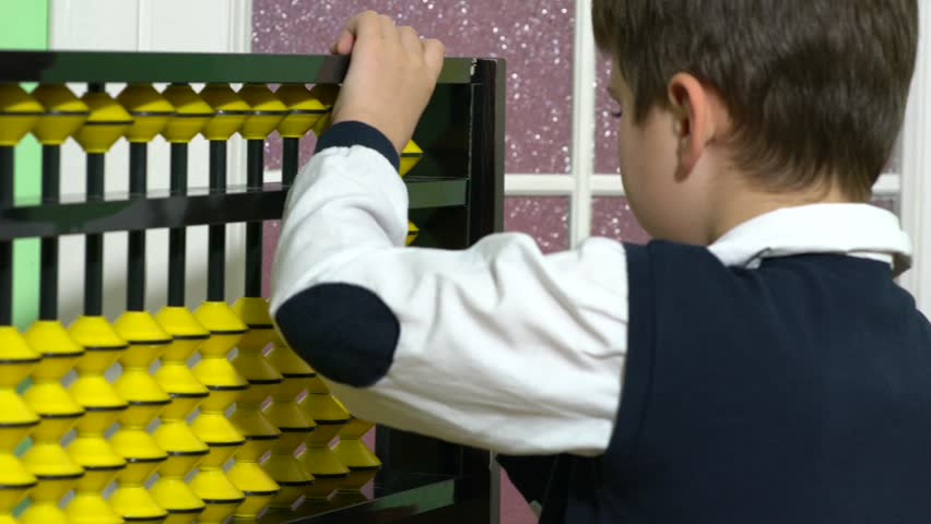 Handsome boy holding big ancient wooden abacus calculation.  | Shutterstock HD Video #33059878