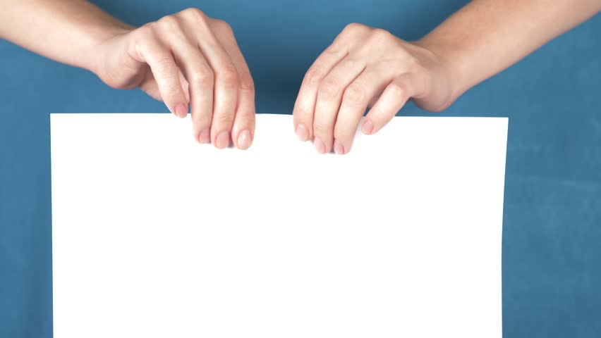 Hands tearing paper sheet, closeup on a turquoise background. 4k, slow motion   Shutterstock HD Video #33078985