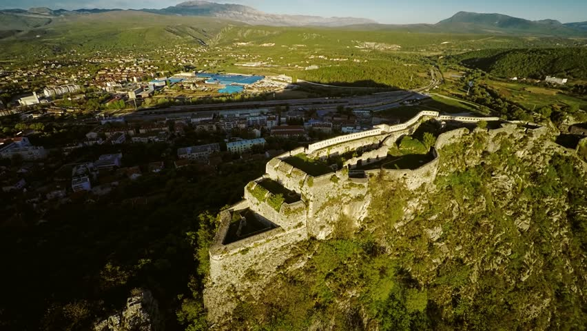 Aerial View Of The Old Military Fortress Ruins On The Hill Spas Above The  City Knin