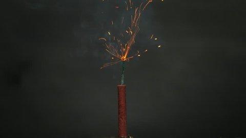 Burning fuse exploding firecracker