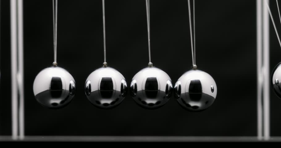 Newton's cradle office toy. Studio shot of swinging metal balls on black background. | Shutterstock HD Video #33150064