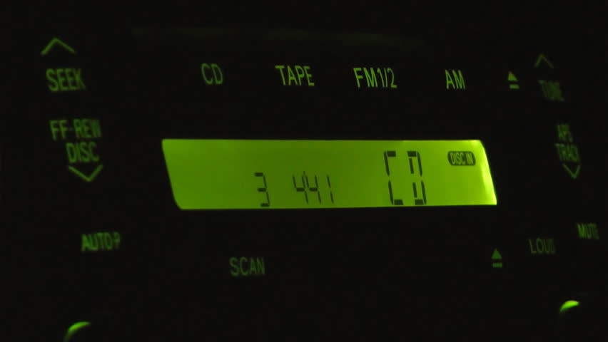 Close-up shot of car's CD player at night