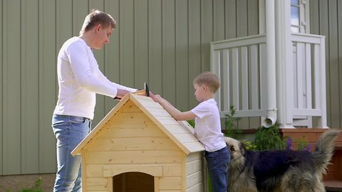 Father and son build a kennel