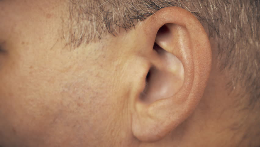 Man left ear. Macro extreme close up view of male ear. Concept for audio music sound health human ear. | Shutterstock HD Video #33170494