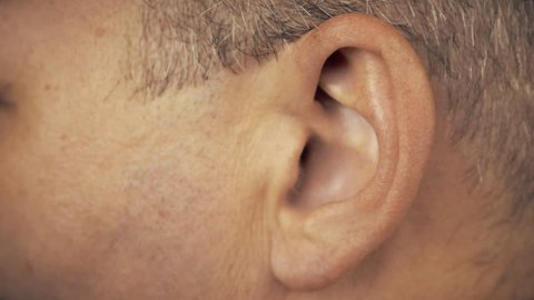 Man left ear. Macro extreme close up view of male ear. Concept for audio music sound health human ear.
