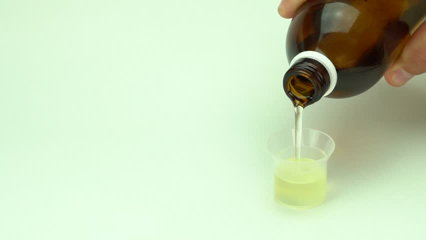 Syrup poured into the dispenser with vitamins and supplements | Shutterstock HD Video #33179434