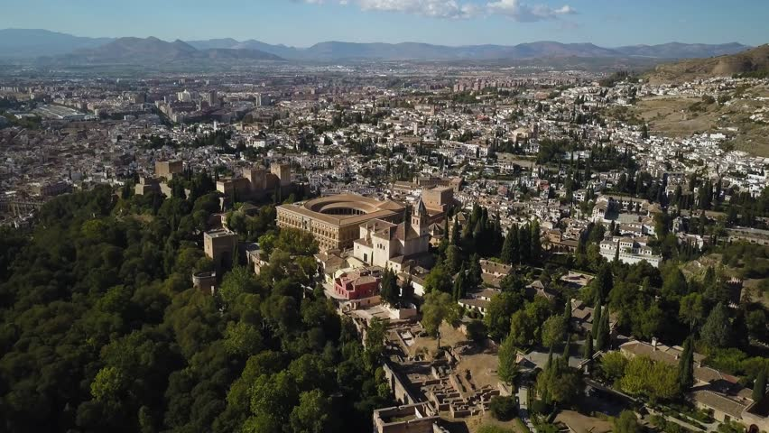 4k aerial drone footage - Ancient medieval castle, The Alhambra, of Granada Spain.  This mighty fortress was built by the Moorish Caliphate when they controlled much of Spain.