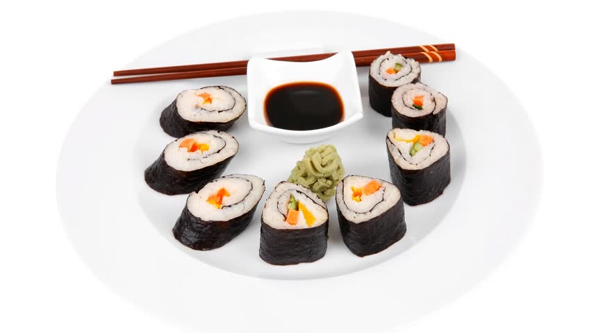 Maki Sushi : Maki Rolls and California rolls made of fresh raw Salmon(sake) Tuna(maguro) and Eel(unagi) . on white dish with sticks hidef slow motion intro