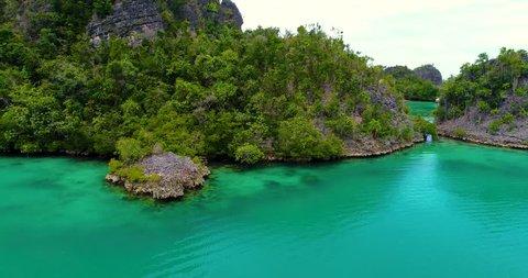 AERIAL: Pianemo Islands, Blue Lagoon with Green Rocks, Raja Ampat, West Papua, Indonesia.