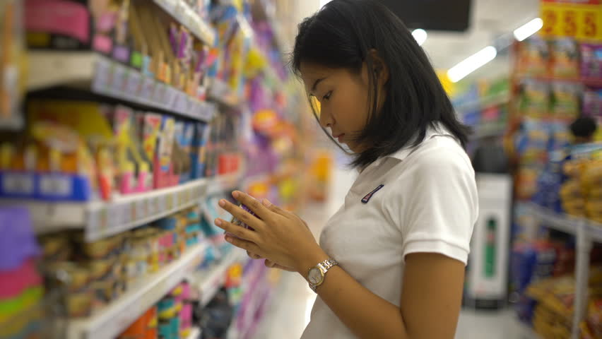 Woman reading label on canned food at super market  | Shutterstock HD Video #33280924