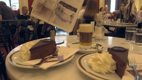 VIENNA, AUSTRIA - SEPTEMBER 07, 2017: Hotel Sacher with dessert on table. This 5 star hotel is famous for the speciality Sacher torte which is a chocolate cake with apricot filling.