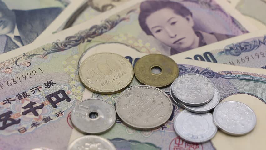 Japanese banknotes and japanese coins on white table. | Shutterstock HD Video #33325414