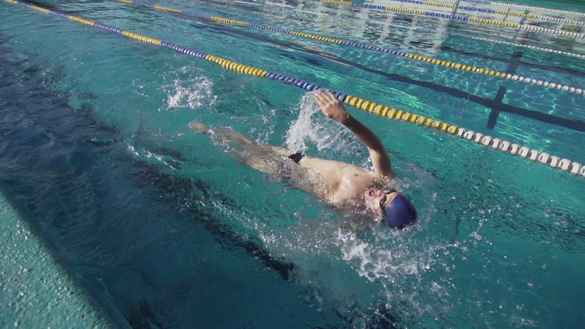 Slow Motion Of Professional Swimmer Swimming The Backstroke
