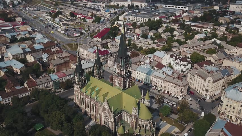 Fly around an old Gothic cathedral in old European city
